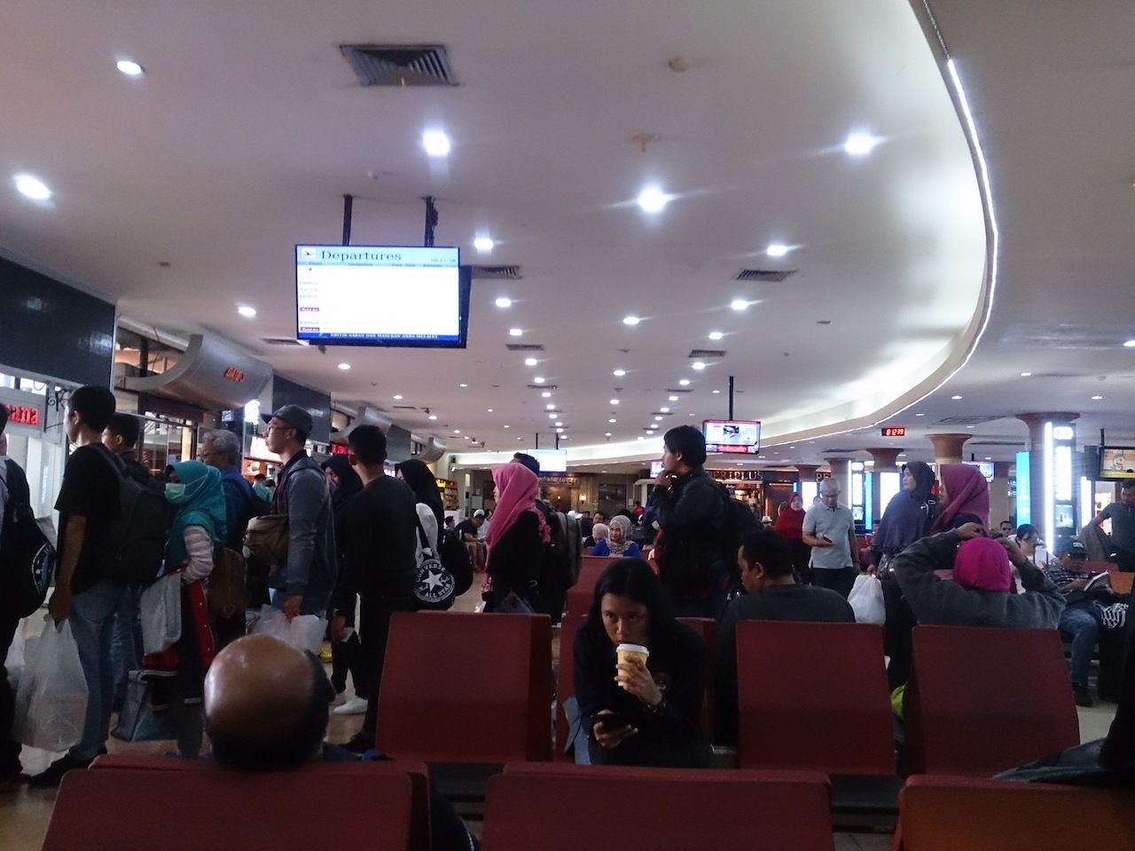 Crowd of travelers at Adisutjipto International Airport