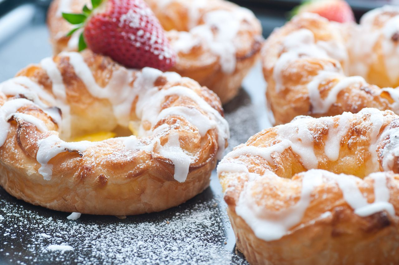Danish pastries with white glaze and powdered sugar
