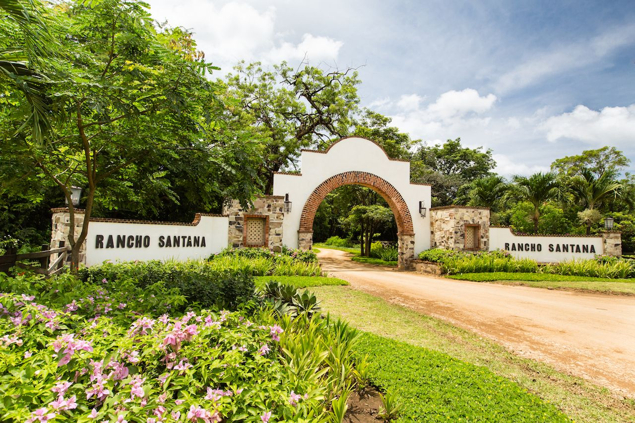 Entrance to Rancho Santana resort in Nicaragua surrounded by greenery