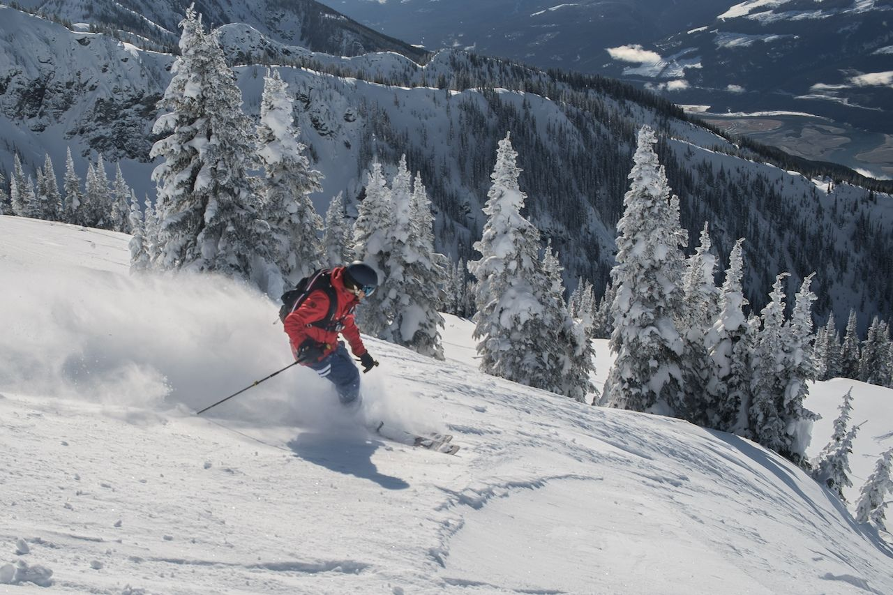 Free ride ski touring skiing, airbag, deep powder in backcountry alpine heli skiing, Revelstoke, British Columbia, Canada