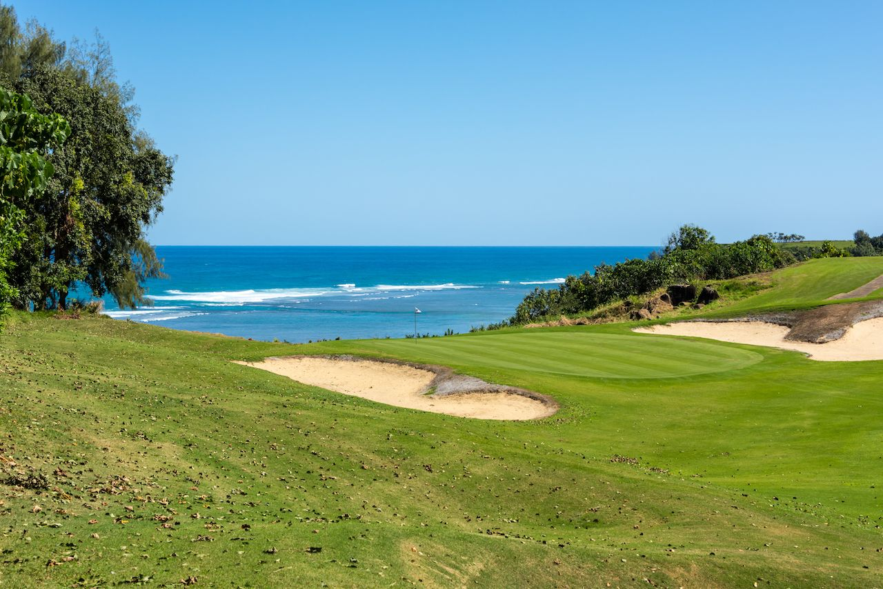 Golf course with a beautiful view of the turquoise ocean on Kauai, Hawaii