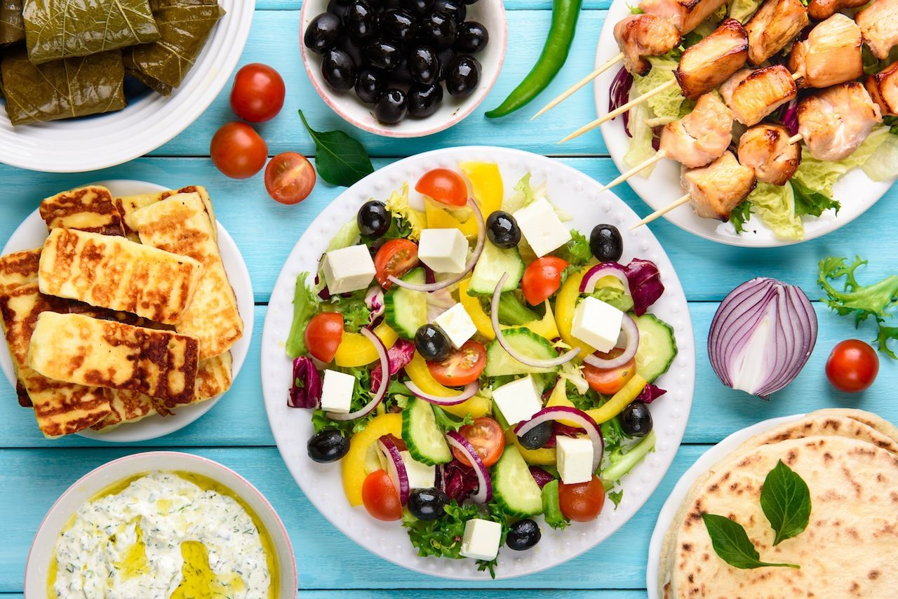 Greek food mix on a blue wooden background