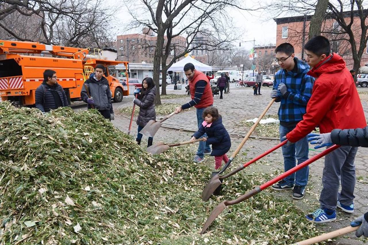 Group of people raking leaves