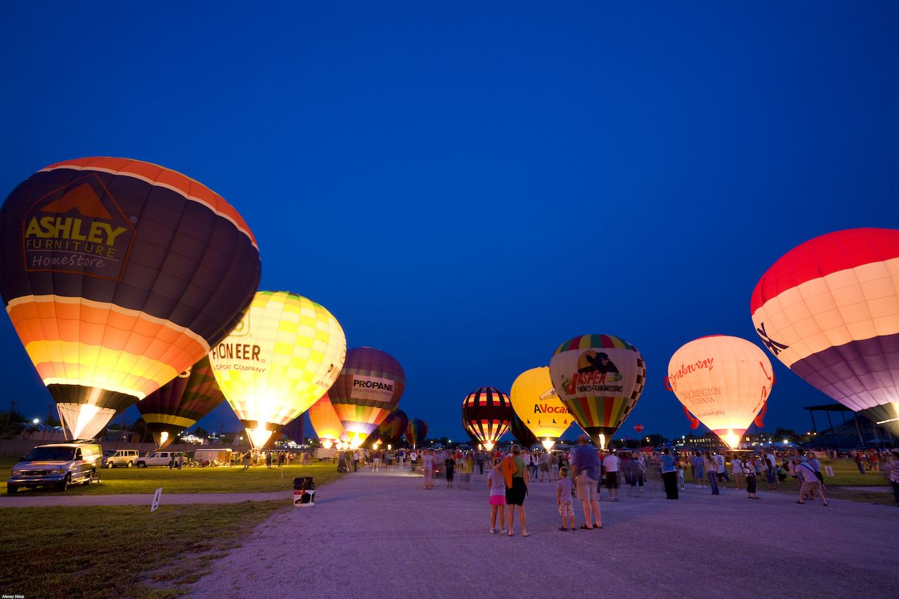 Hot air balloons light up the evening sky at Indiana State Fairgrounds