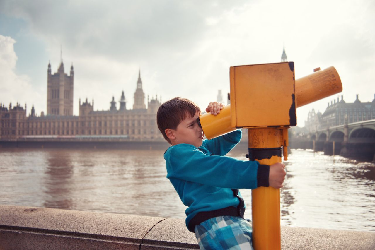 Kid at viewing machine overlooking London