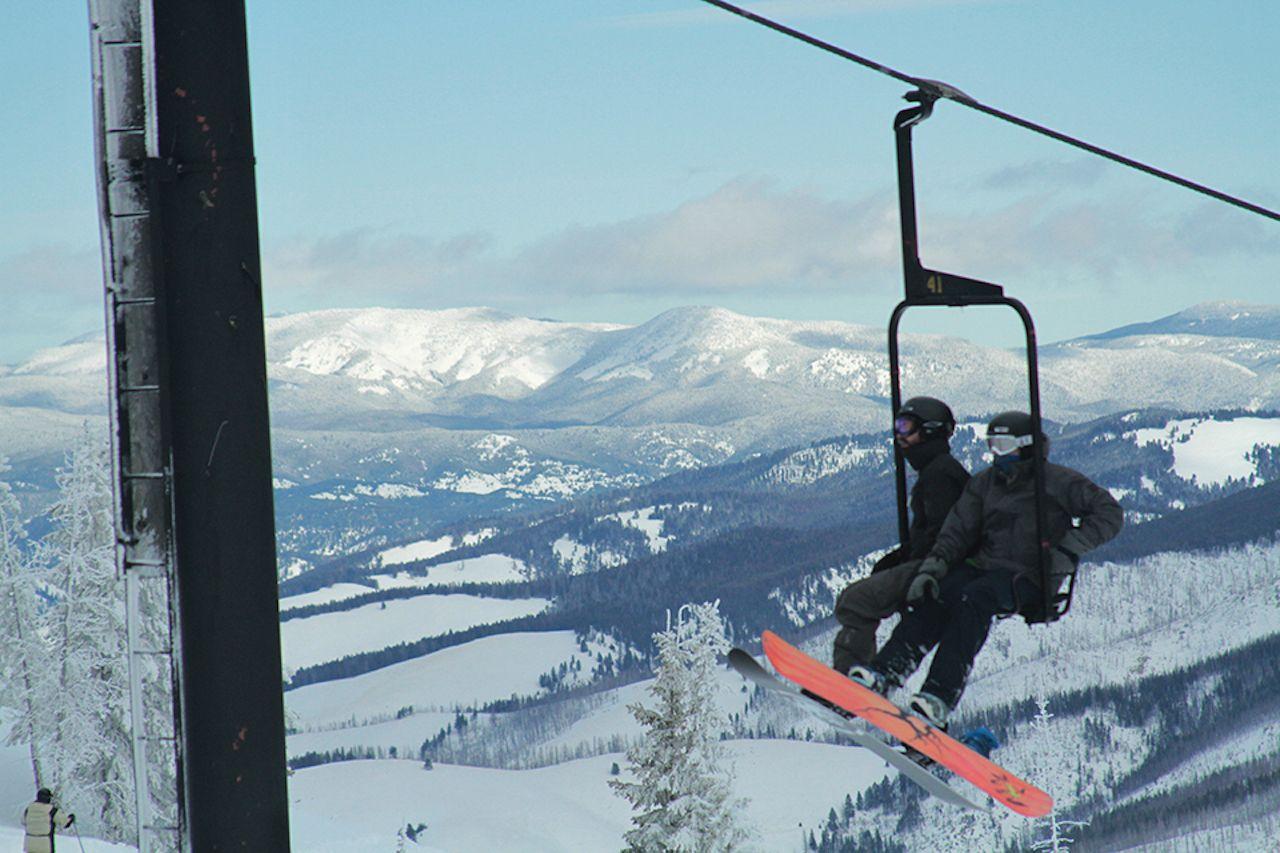 Lost Trail Ski Area ski lift with snowboarders