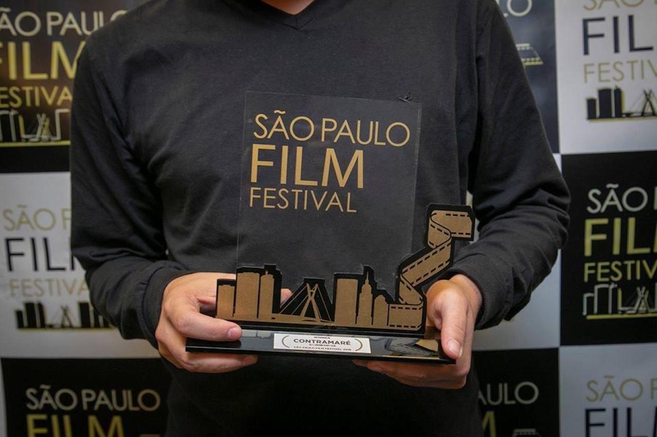Man holding Sao Paulo Film Festival award