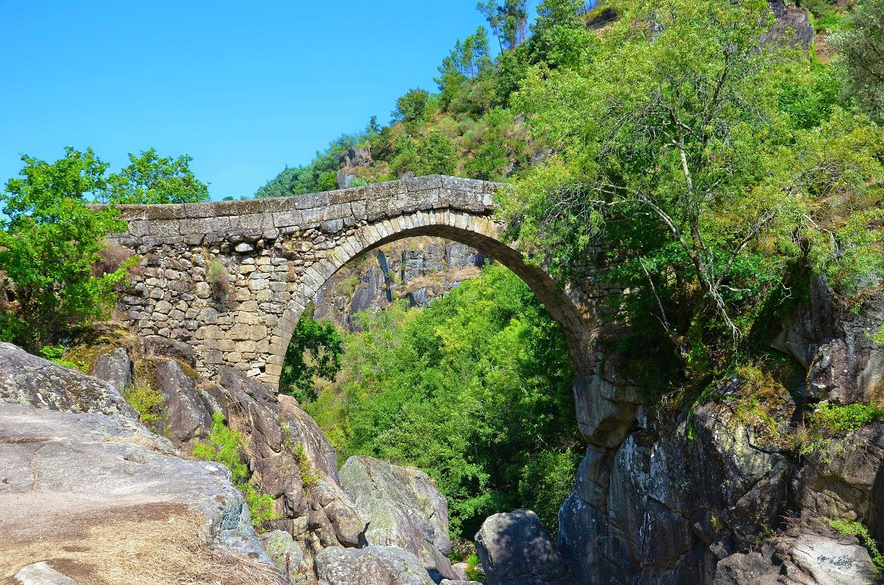 Misarela Bridge surrounded by rocky landscape and green forest in Peneda-Geres National Park, northern Portugal
