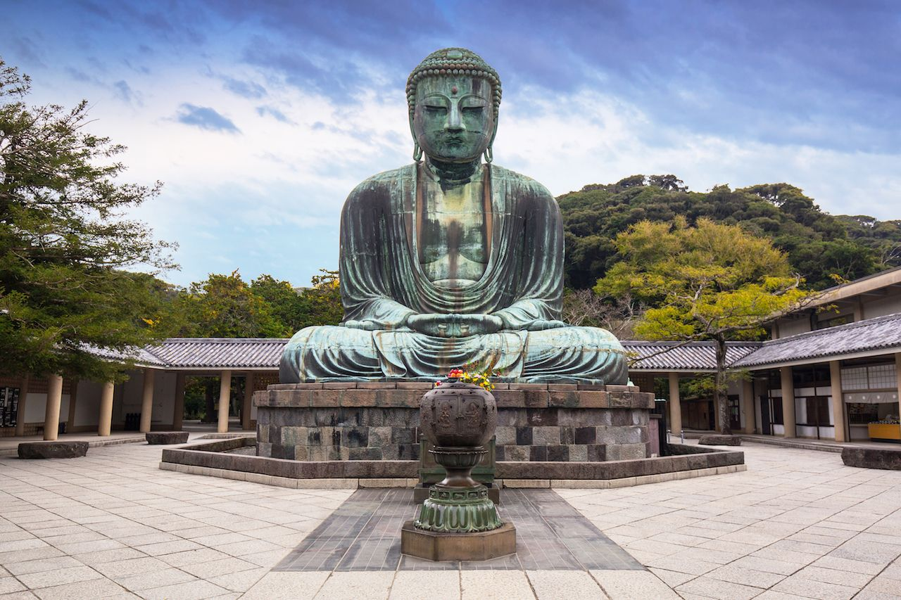 Monumental bronze statue of the Great Buddha in Kamakura, Japan