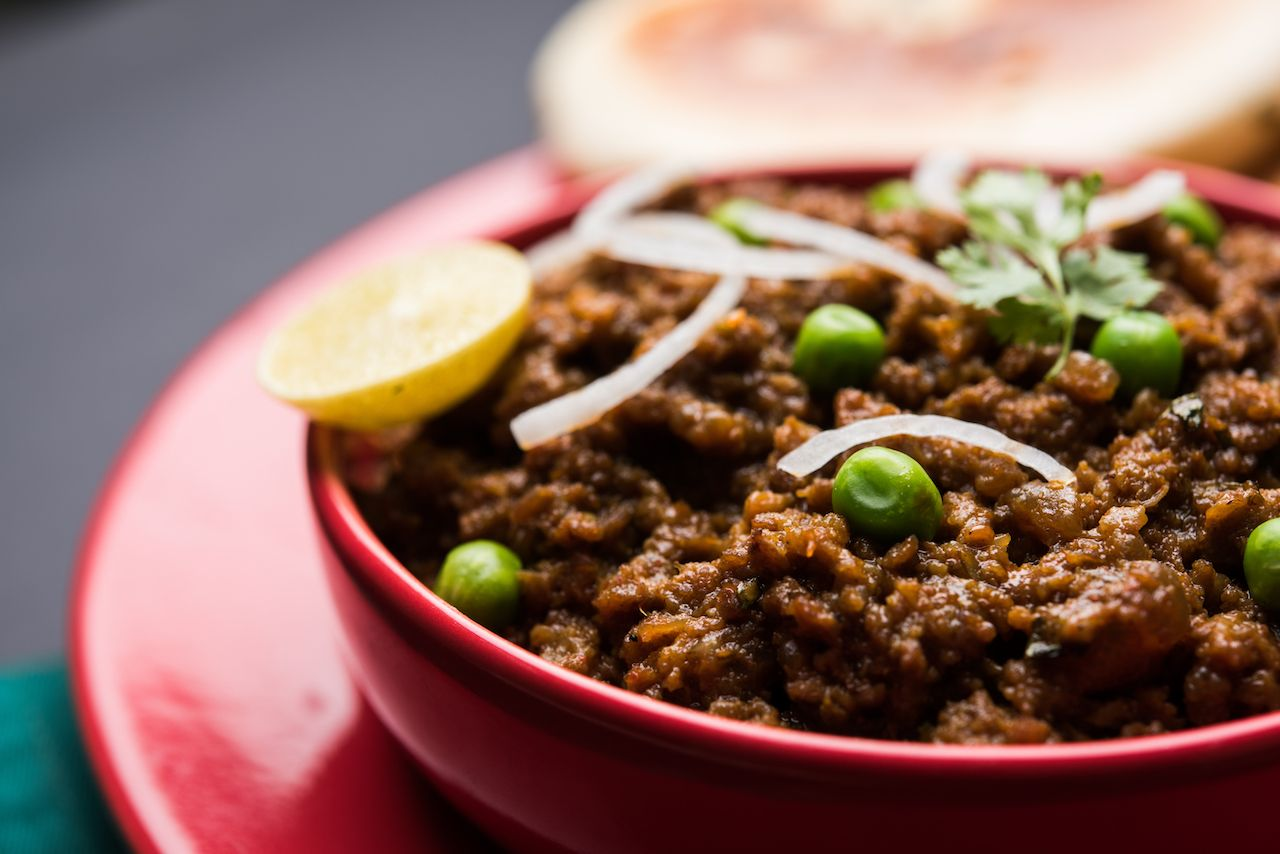 Mutton curry from India with peas and onions