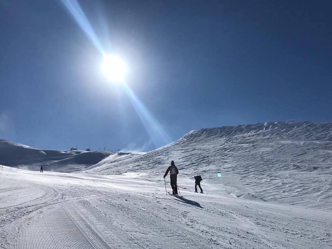 Skiers on fresh white powder on a Lebanese mountain