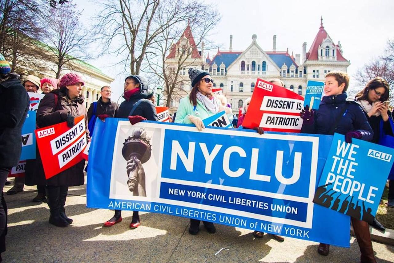 NYCLU volunteers holding signs