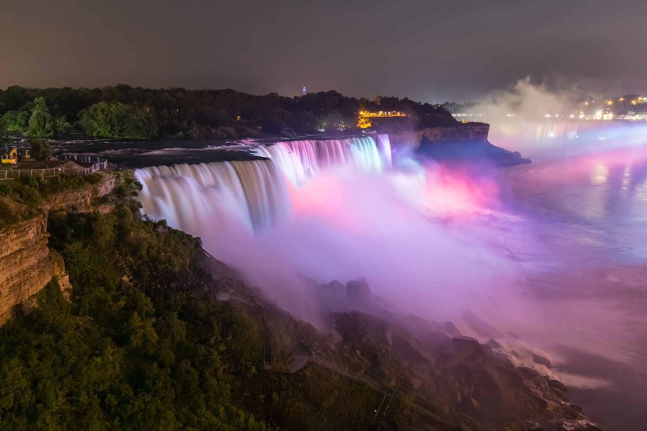 Niagara Falls illuminated pink at night