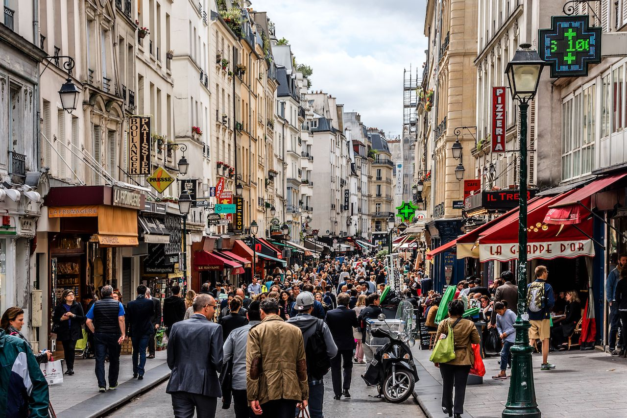 People on a busy French shopping street
