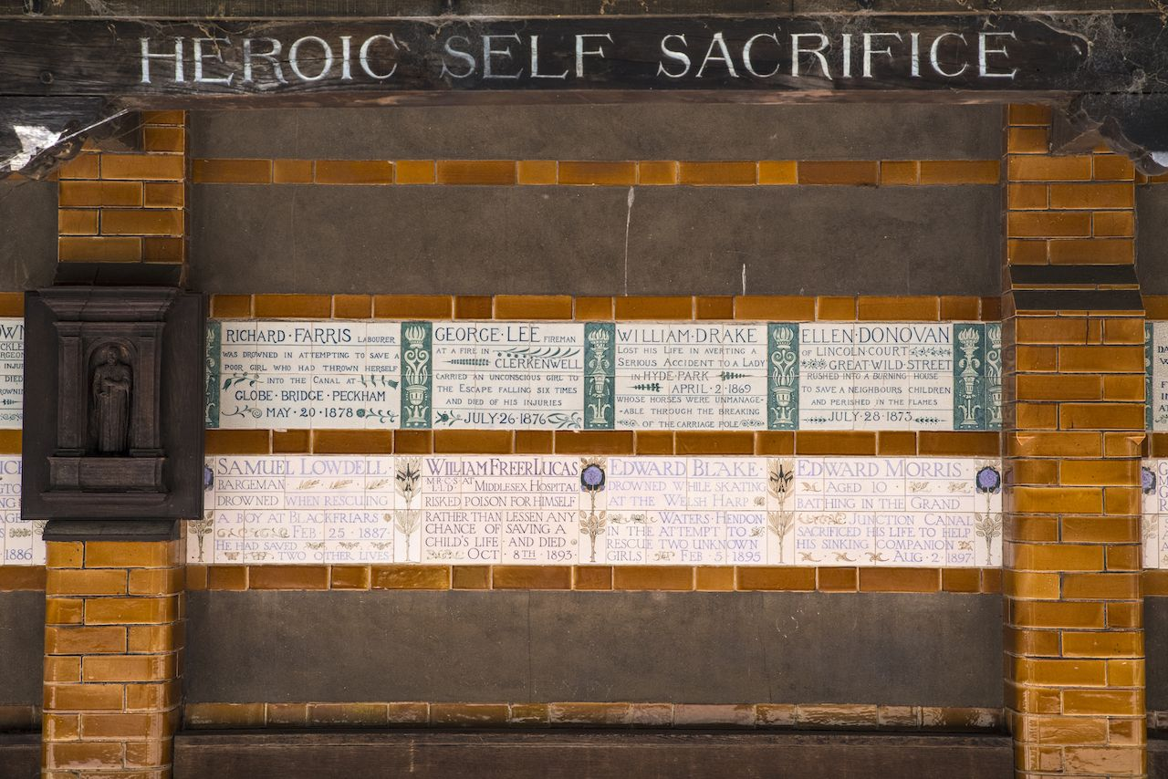 Plaques at the Memorial to Heroic Self-Sacrifice located in Postmans Park in London