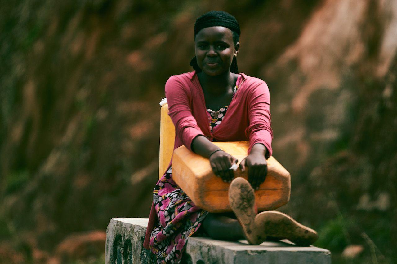 Portrait of a woman from Rwanda in a pink dress