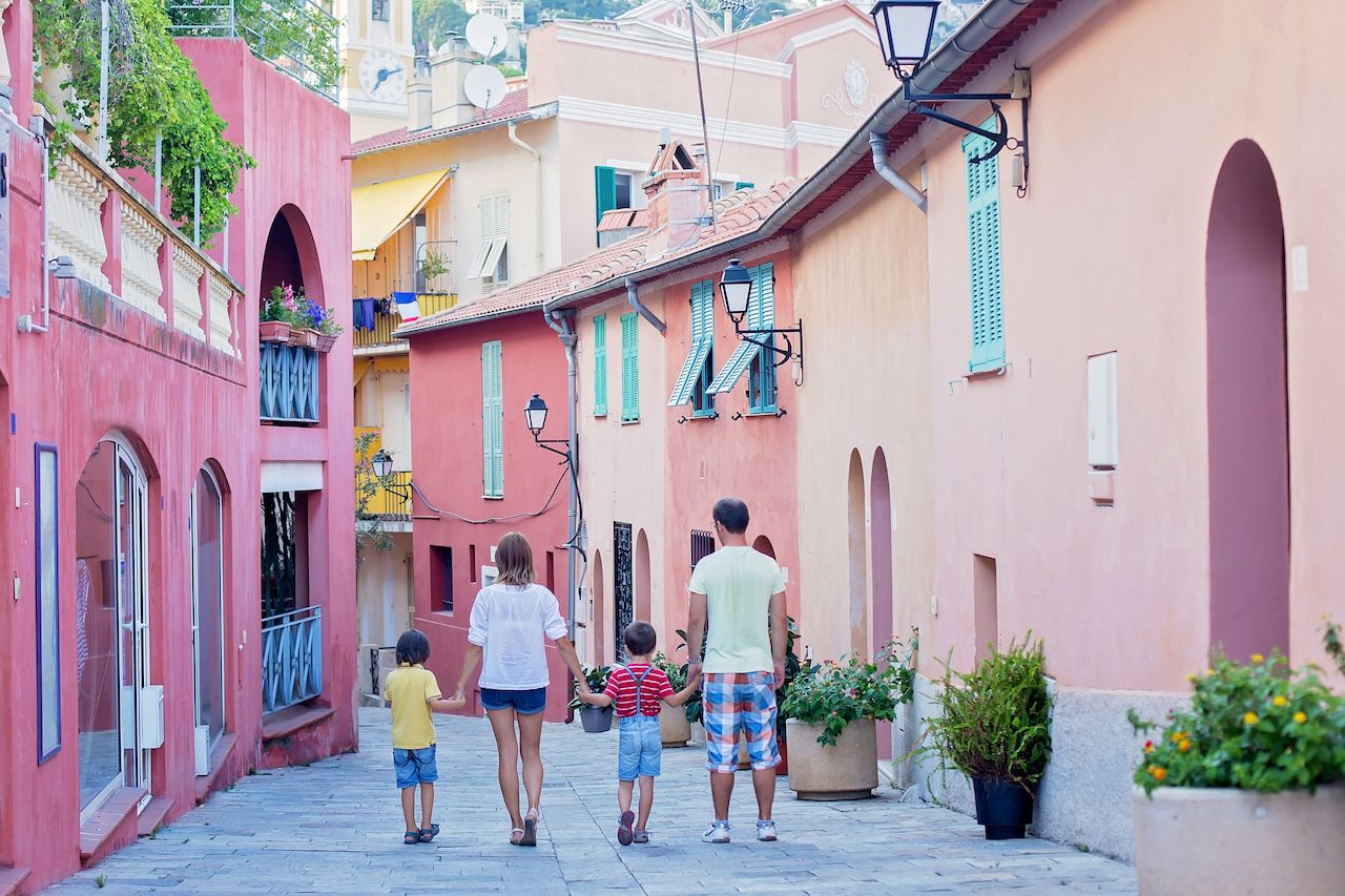 Portrait of family of four, walking on the streets of Villefranche, Nice, France