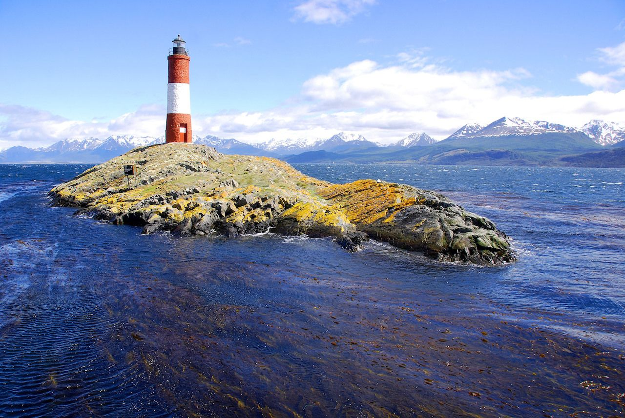 Red and white lighthouse in blue sky in Beagle Channel Ushuaia Patagonia Argentina