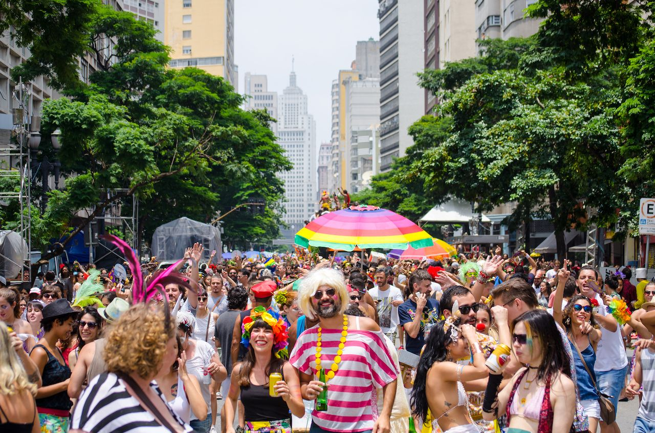 Revellers participate in the Tarado and voce street block during Carnaval