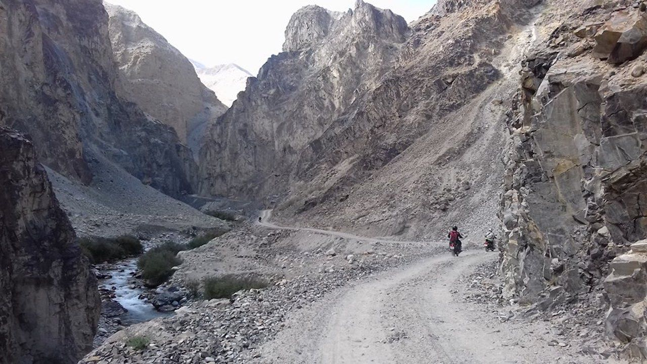 Ride The Himalayas motorcylists traversing a mountain pass