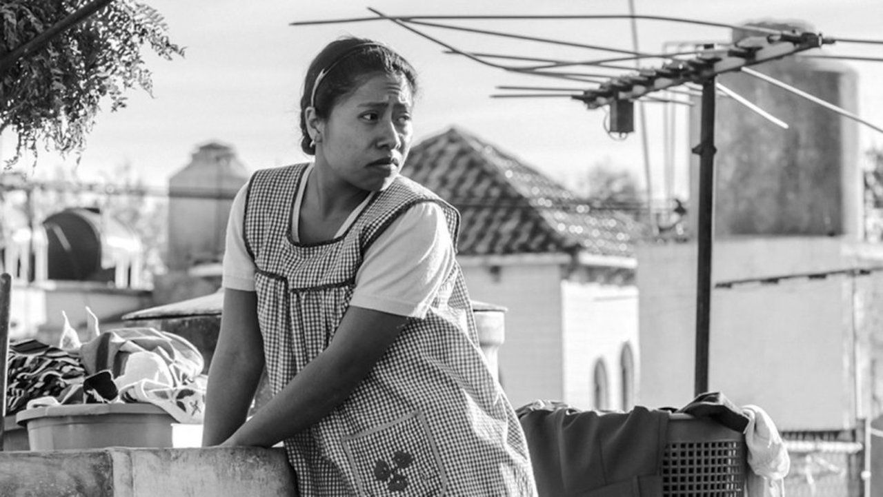 Roma still frame of a woman doing laundry