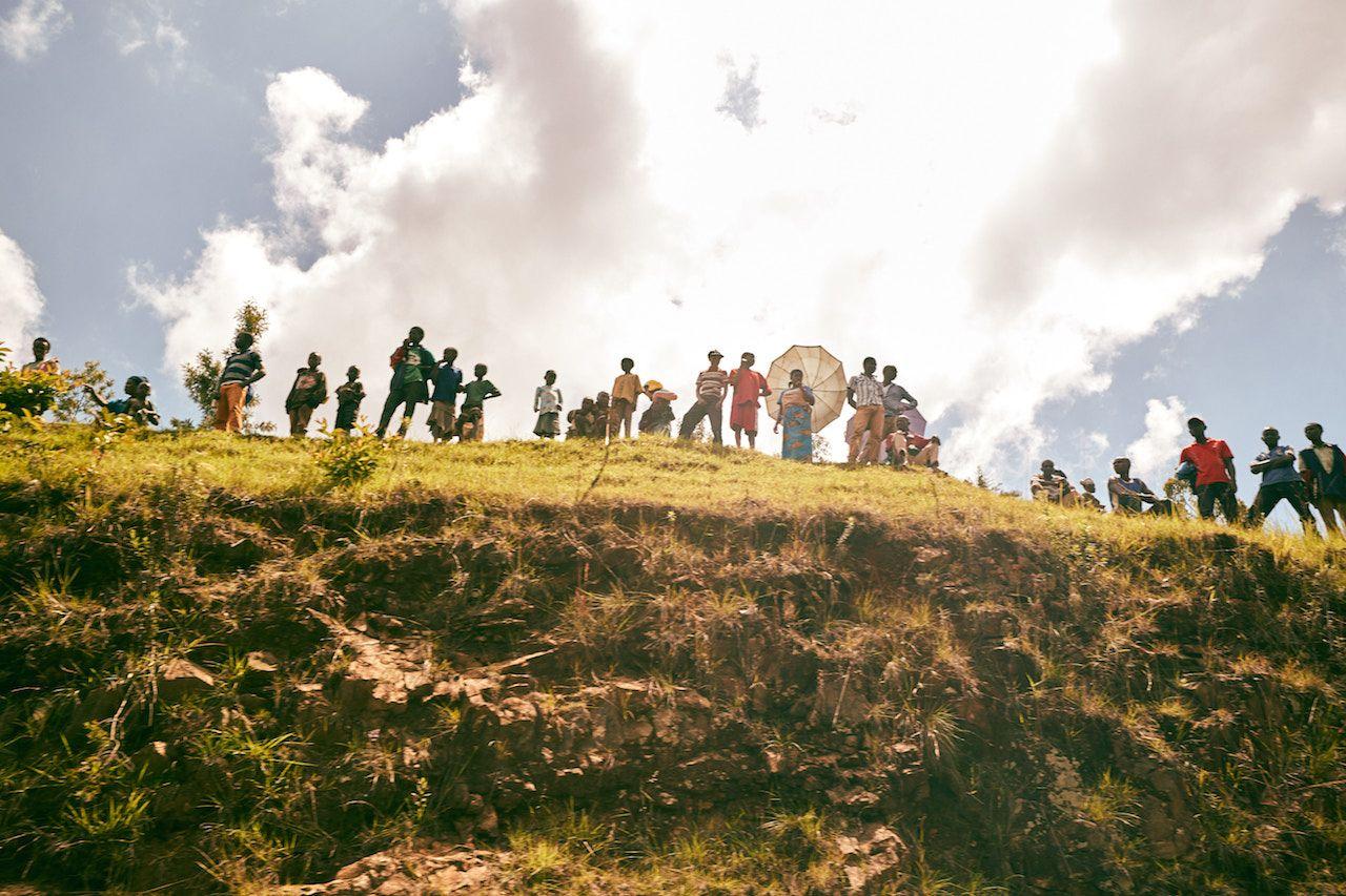 Rural Rwandans watching Tour du Rwanda bike race in the countryside