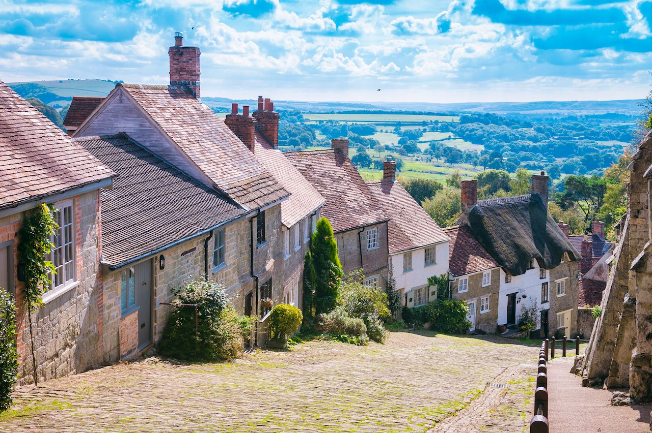 Scenic English countryside view from Gold Hill, in the traditional hillside village of Shaftesbury, England
