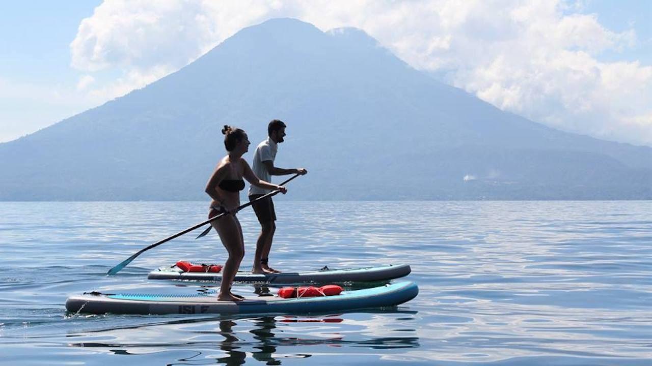 Stand Up Paddlers on Lake Atitlan, Guatemala
