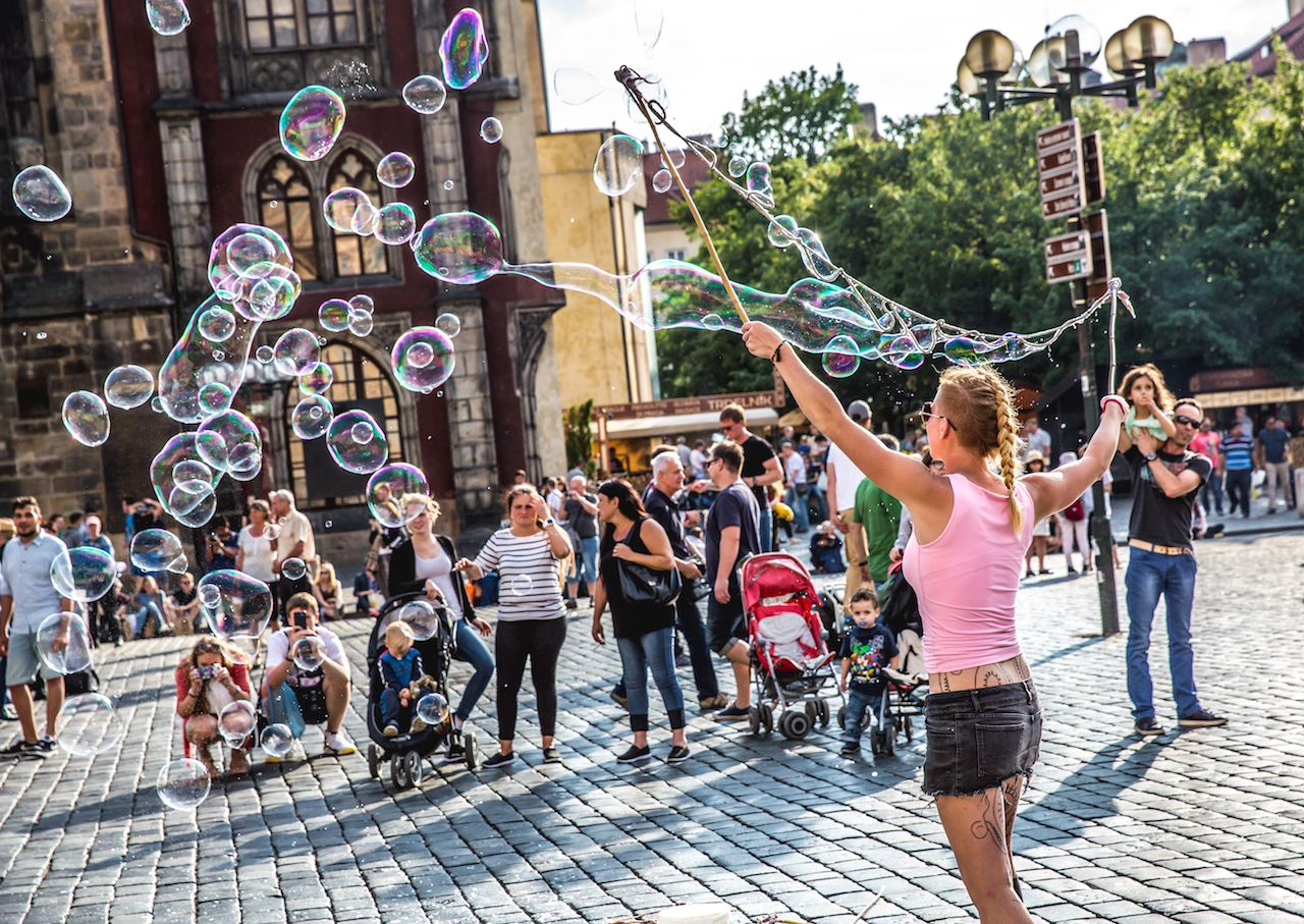 Street Artist making bubbles at Prague Old Town Square