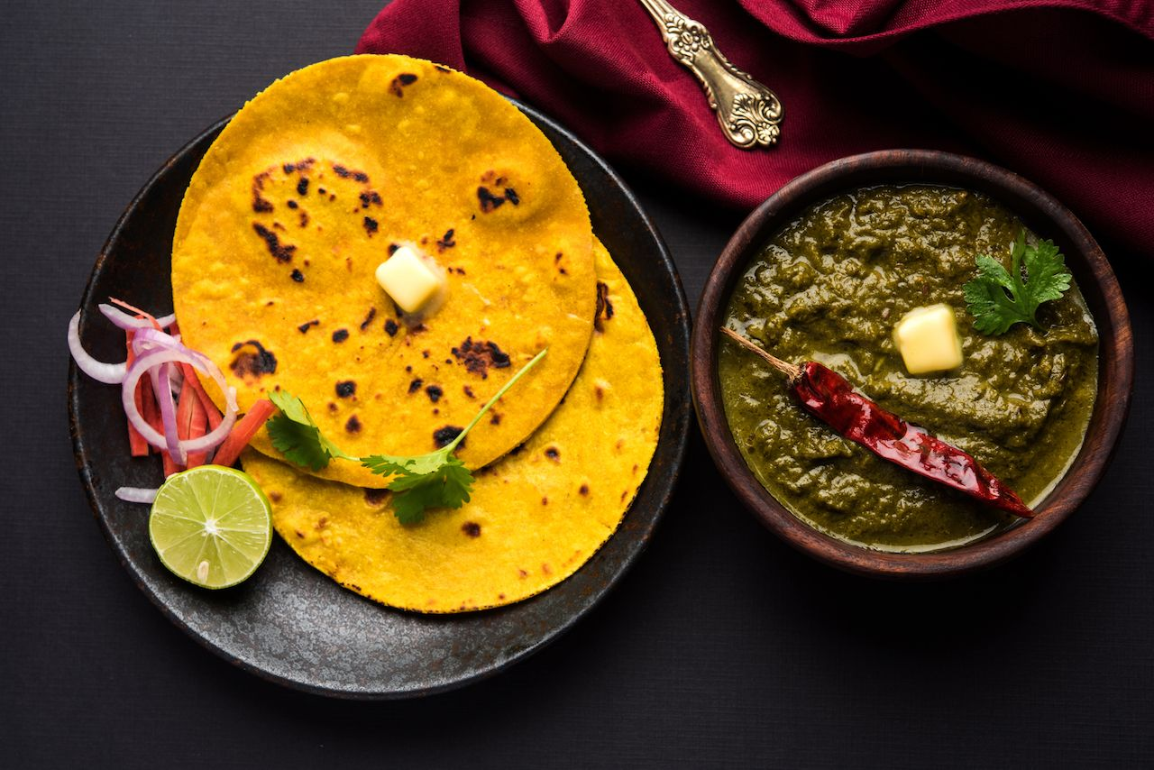 Traditional Indian mustard greens curry with flatbread