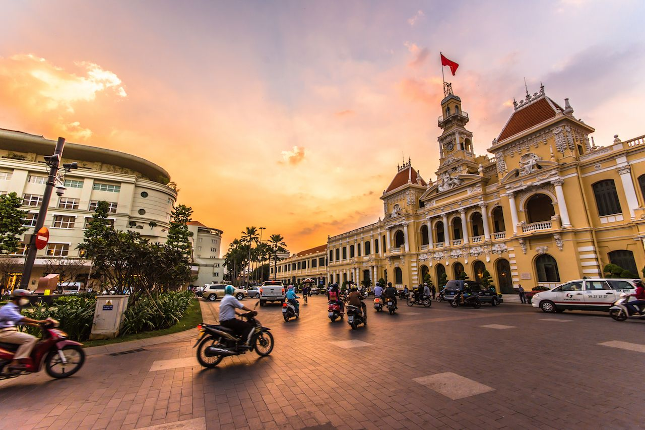 Traffic in front of Ho Chi Minh City Hall at twilight