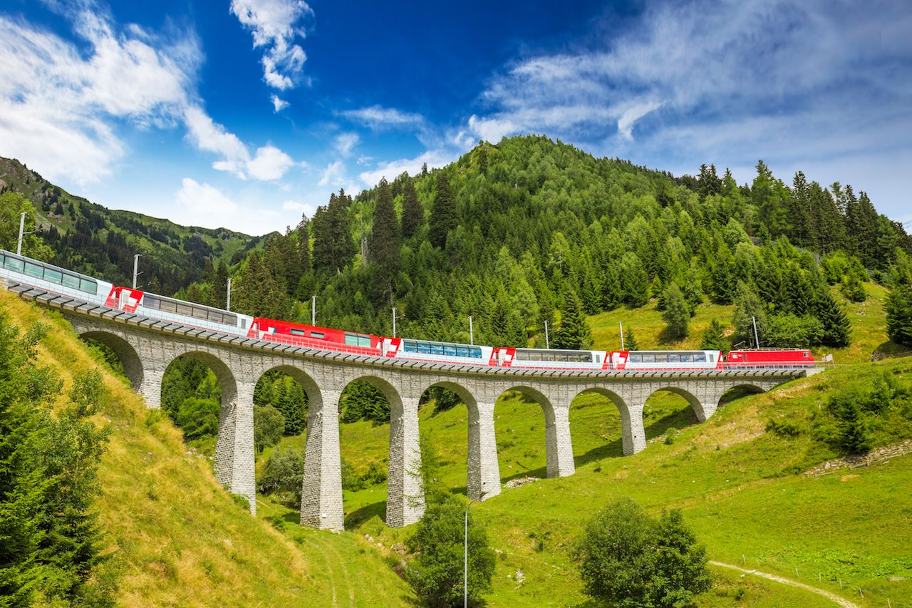 Train on famous landwasser Viaduct bridge in Switzerland