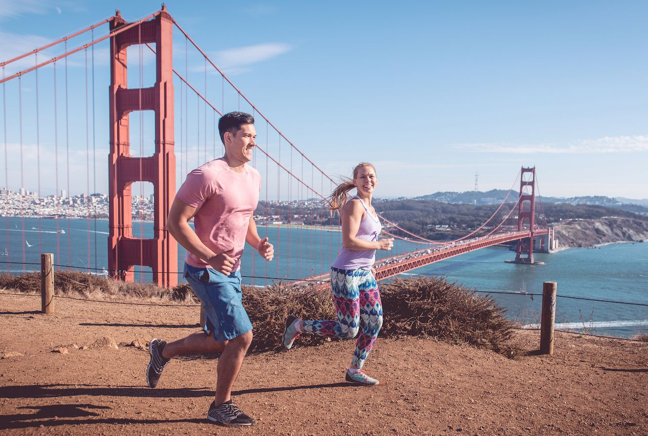 Two people running in San Francisco