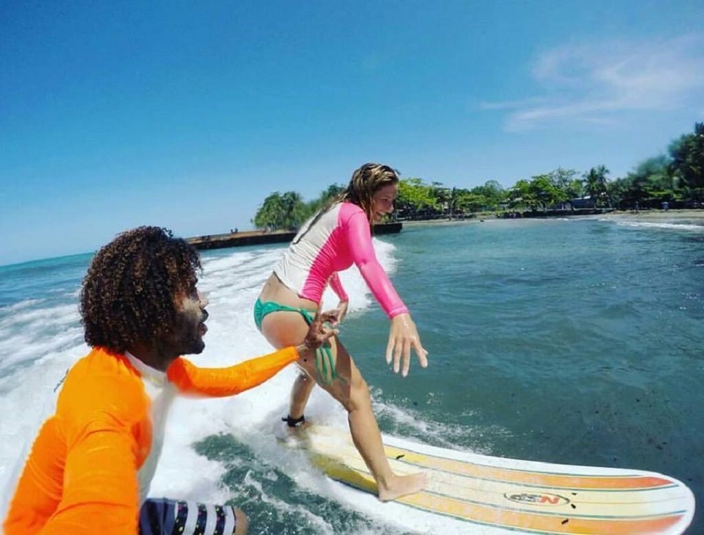Two people surfing in Costa Rica