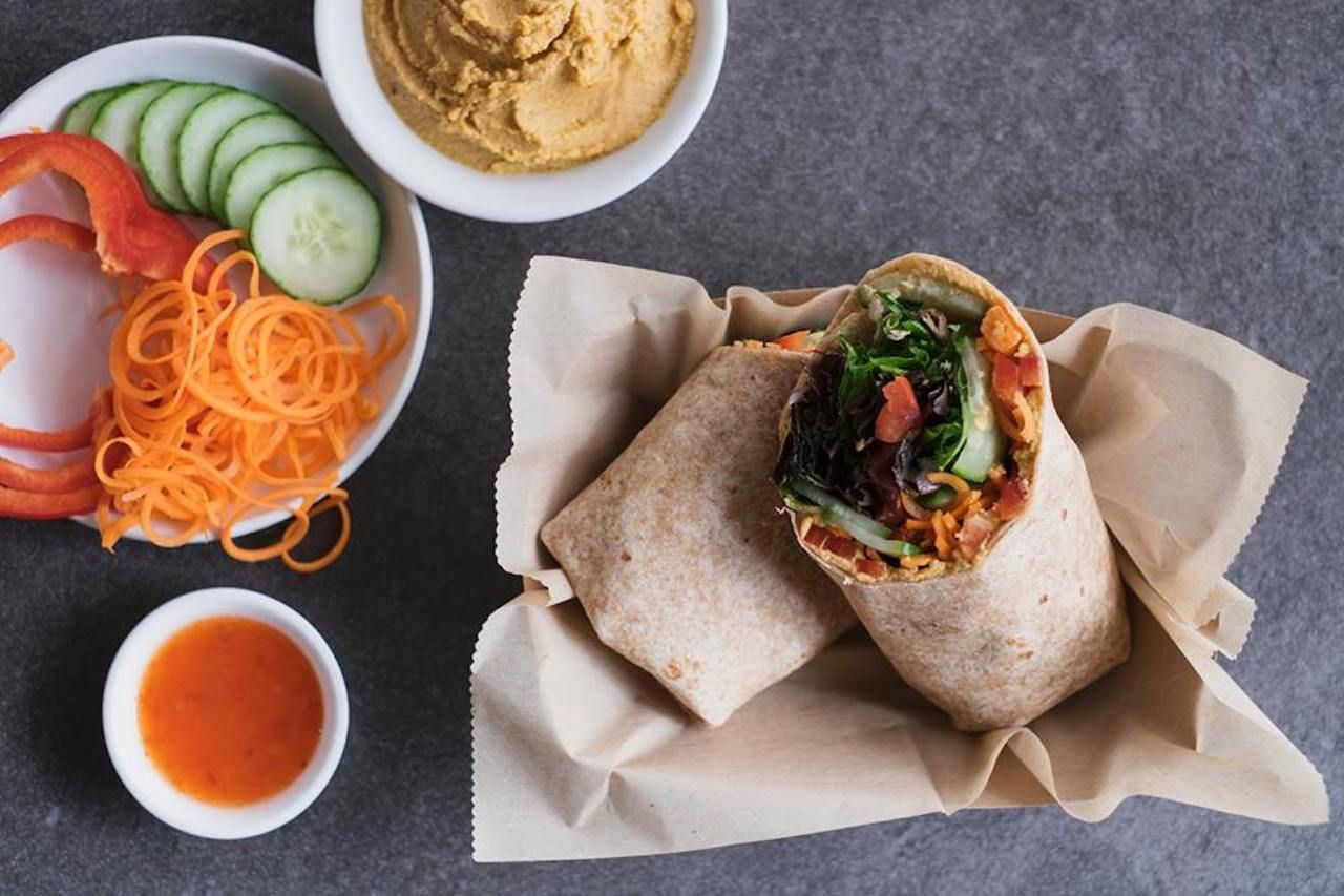 Ultra Coffeebar wrap with veggies and hummus on the side