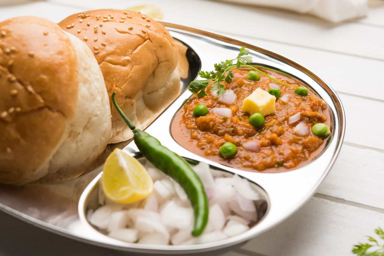 Vegetable curry from India with soft bread rolls