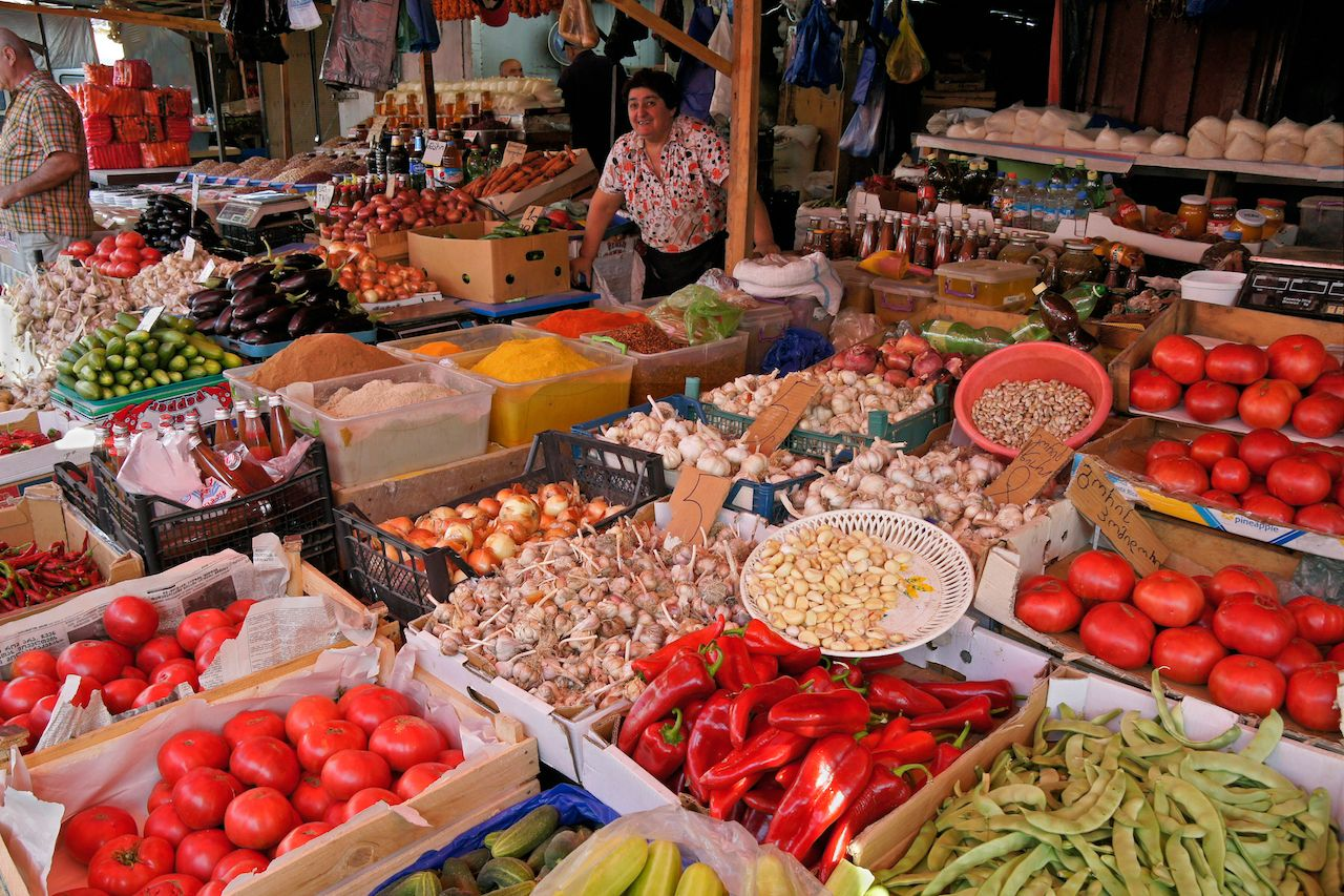 Vendors sell a wide variety of fresh produce, spices, and other products at a bazaar in Georgia