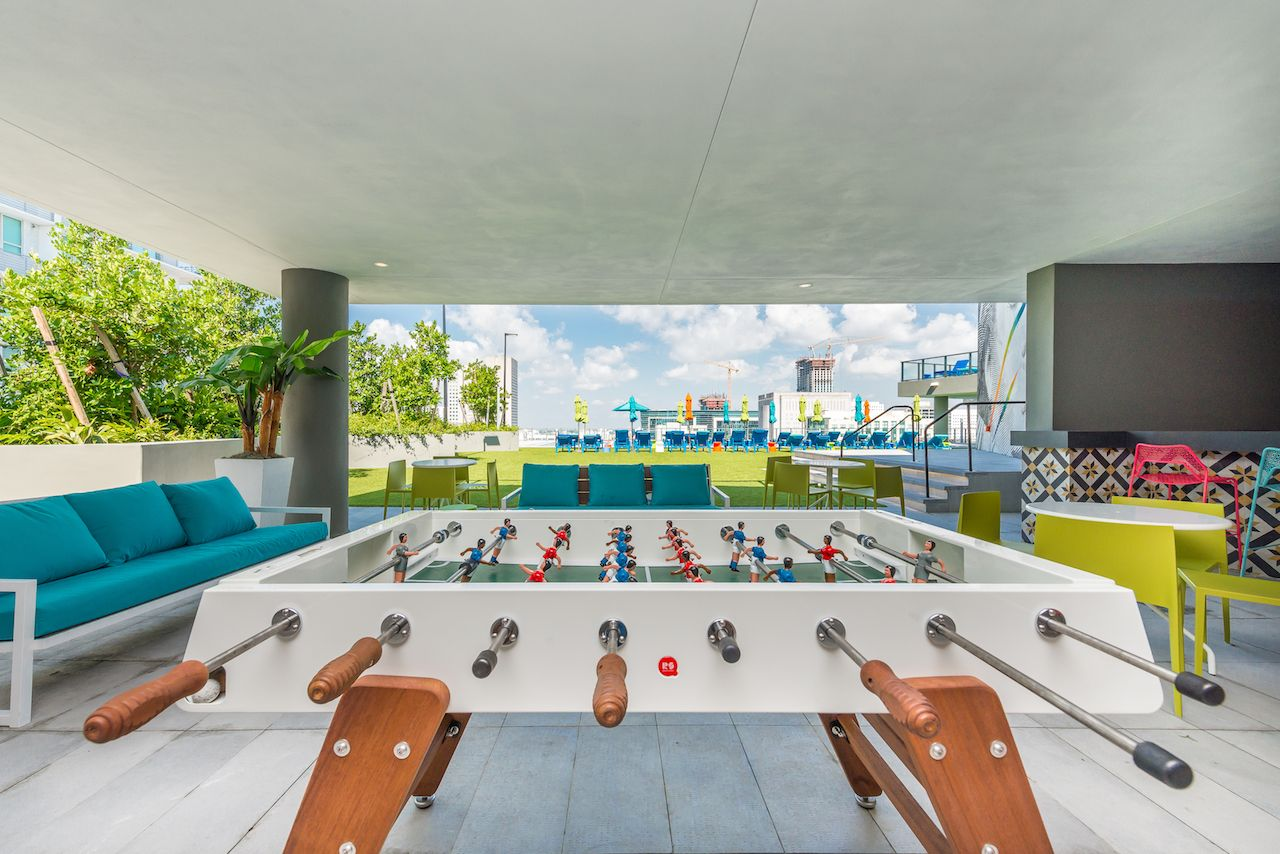 X Miami apartment hotel with foosball table