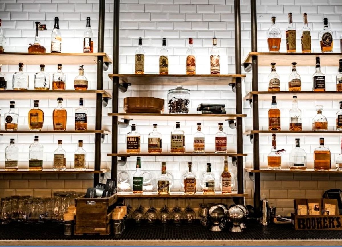 These airport bars will almost make you want to miss your flight