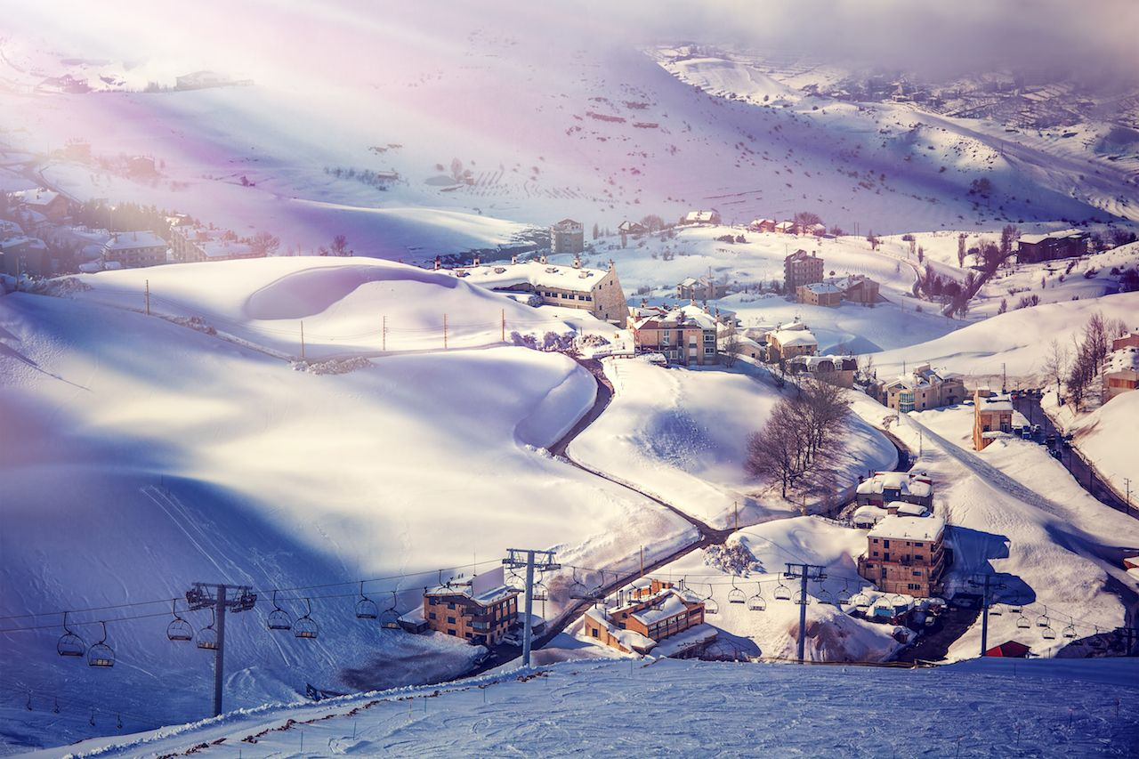 beautiful ski resort, mountain covered with snow, and luxury cottages in Lebanon