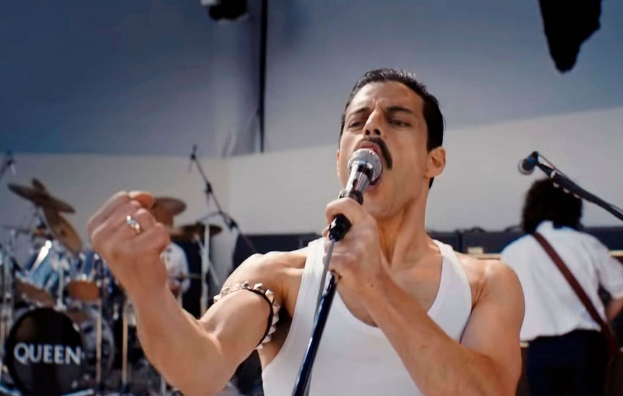 bohemian rhapsody still frame of rami malek singing as freddie mercury