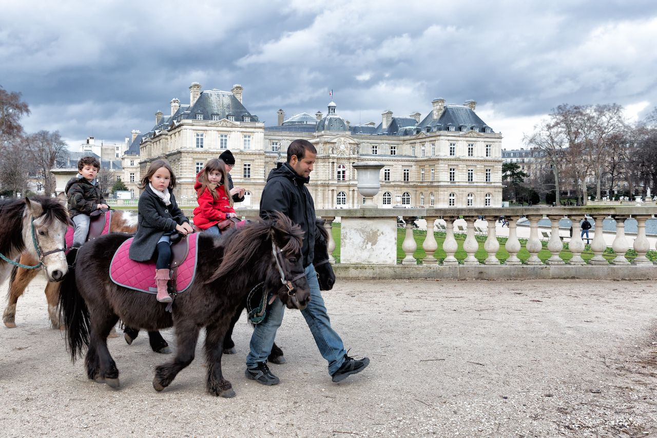 kids ride ponies at the Luxembourg Gardens