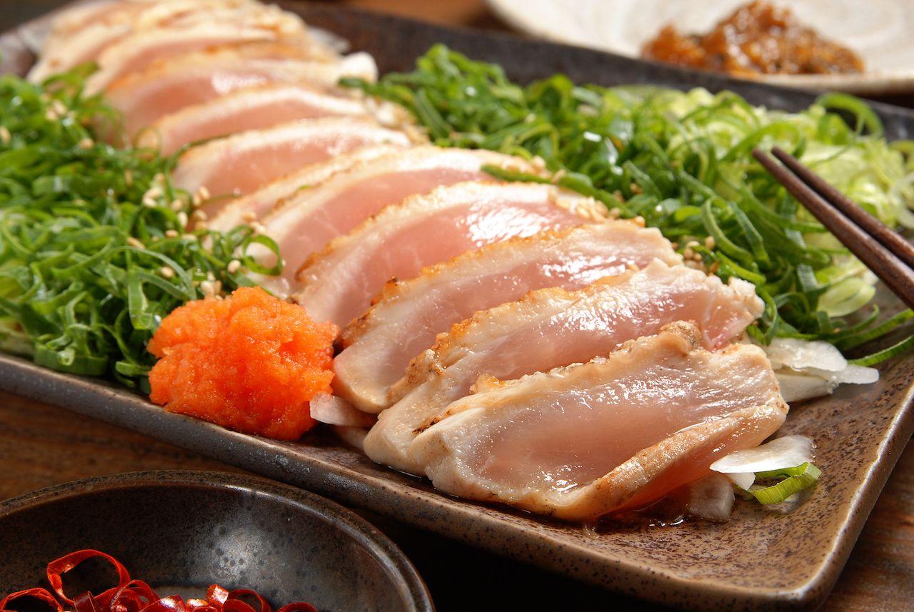 Eating raw chicken sashimi in Tokyo