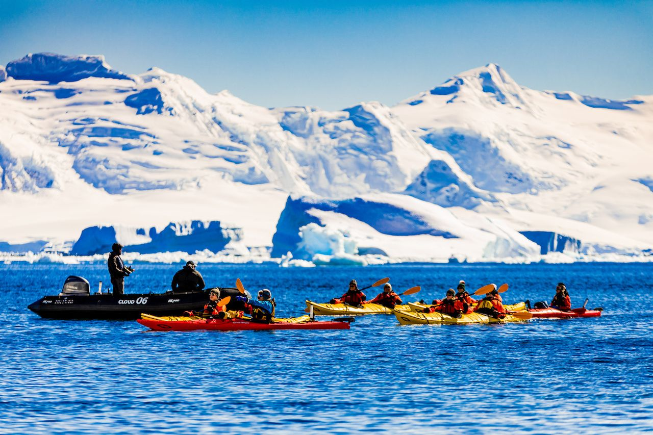 tourists kayaking in antarctic waters