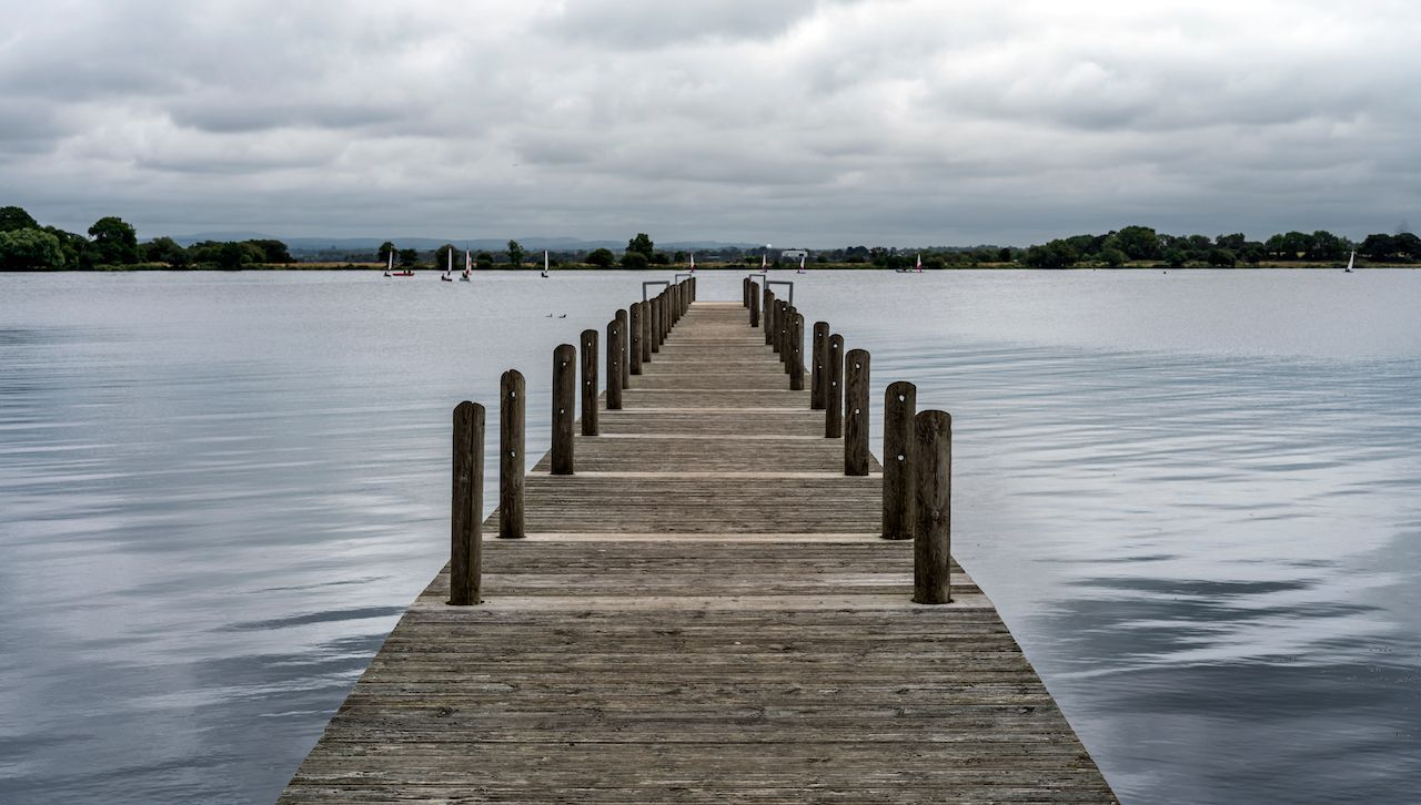 An old Jetty leading to sailing boats at Oxford Island, Northern Ireland