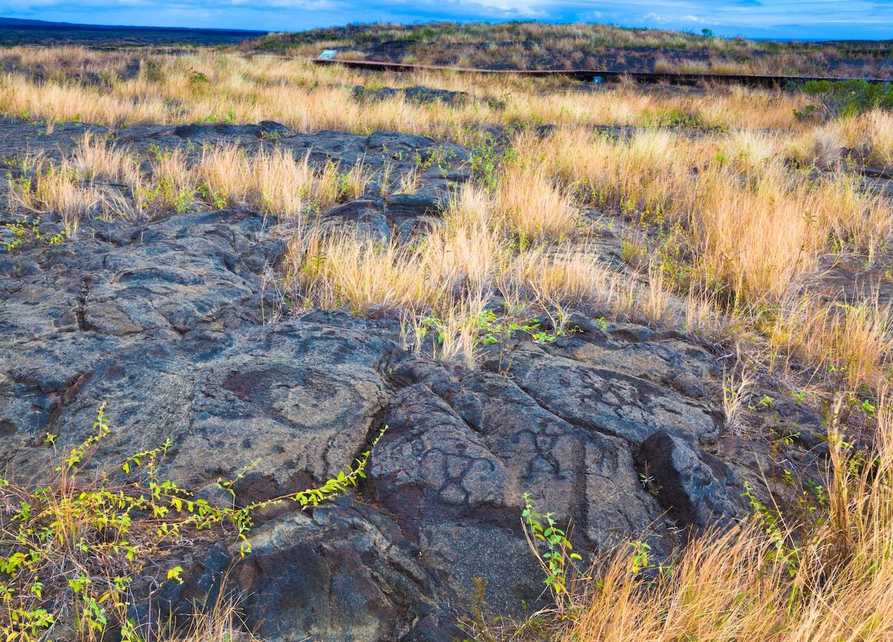 Ancient petroglyphs on lava along the trail in Hawaii Volcanoes National Park, Big Island