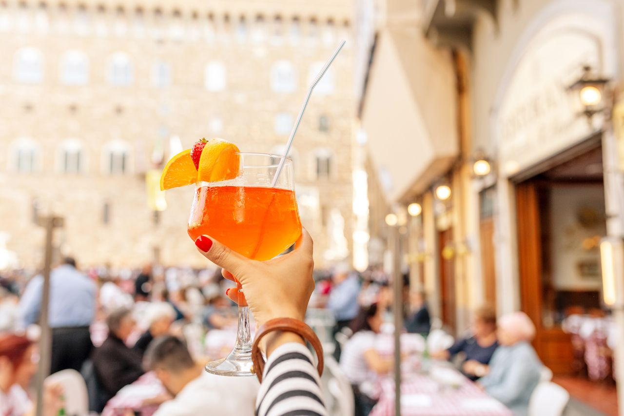 Aperol spritz cocktail decorated with orange and strawberry