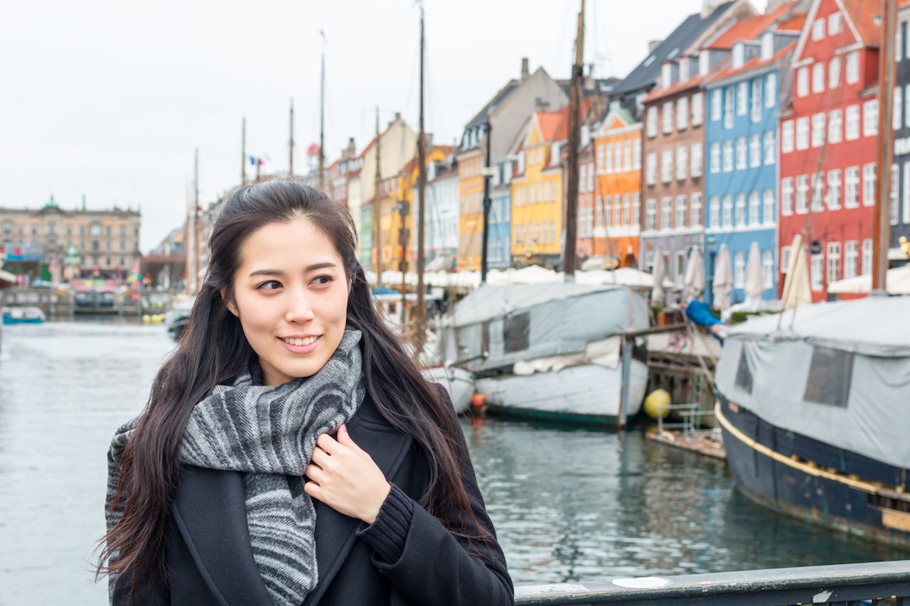 Asian tourist woman at Copenhagen, Nyhavn, Denmark. Tourist in Copenhagen