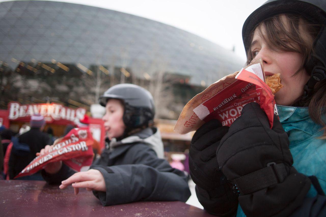 Canadian kids eating BeaverTails