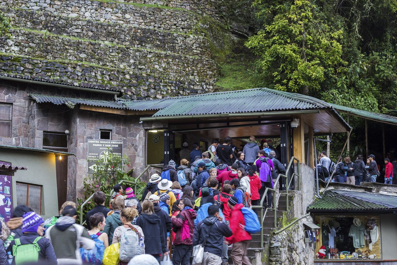 Crowds of tourists in front of the entrance to Machu Picchu
